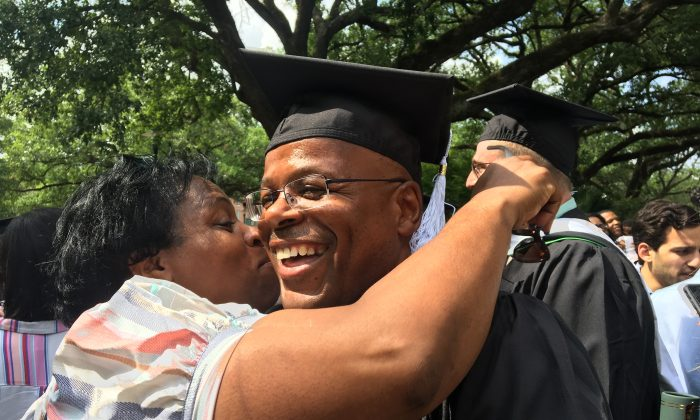 Calvin Duncan (R) with his sister Eva during his graduation from Tulane University in May 2019. (Courtesy of Calvin Duncan)