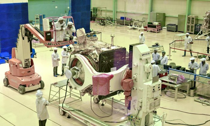 """Scientists work on the orbiter vehicle of """"Chandrayaan-2"""" for India's first moon lander and rover mission. (Manjunath Kiran/AFP/Getty Images)"""