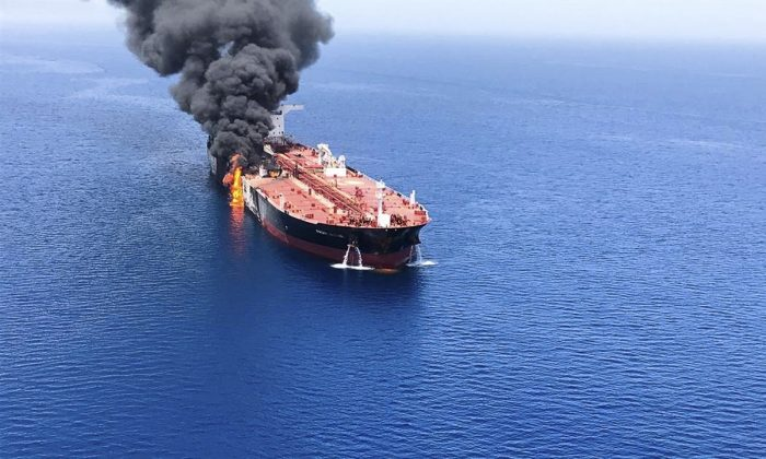 An oil tanker is on fire in the sea of Oman, on June 13, 2019. Two oil tankers near the strategic Strait of Hormuz were reportedly attacked on Thursday, an assault that left one ablaze and adrift as sailors were evacuated from both vessels and the U.S. Navy rushed to assist amid heightened tensions between Washington and Tehran. (ISNA/AP Photo)