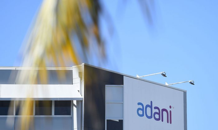 An Adani sign is seen displayed in Townsville, Australia, on May 5, 2019. (Ian Hitchcock/Getty Images)