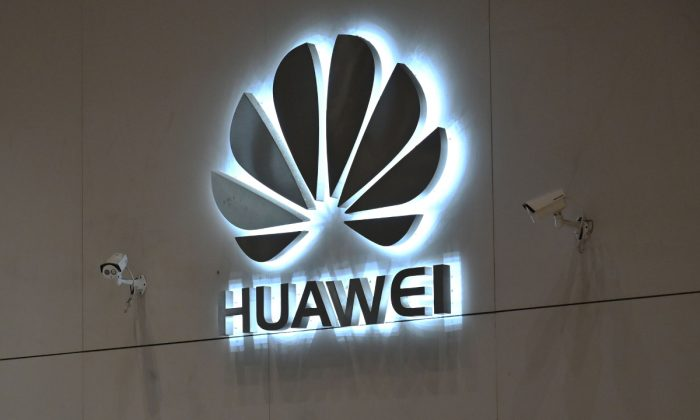 A company logo is displayed at a reception area at the Huawei headquarters in Shenzhen, China's Guangdong Province. (Hector Retamal/AFP/Getty Images)