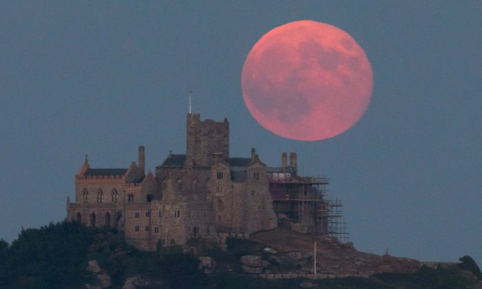 A full moon rises behind St Michael's Mount in Marazion near Penzance in Cornwall, England on June 28, 2018. (Matt Cardy/Getty Images)