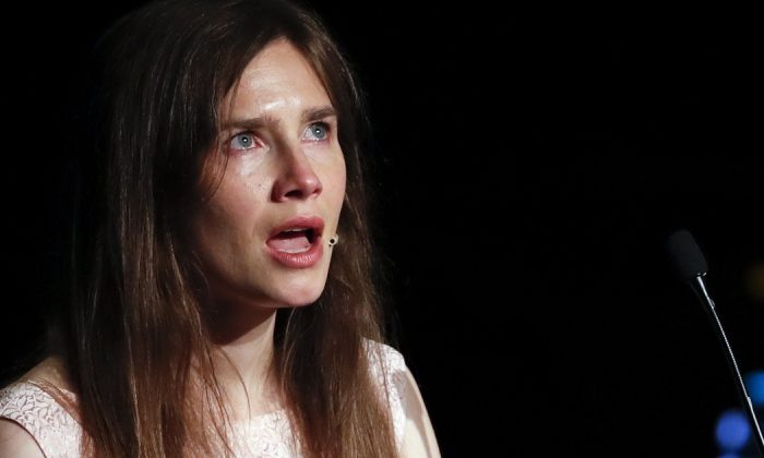 Amanda Knox gets emotional as she speaks at a Criminal Justice Festival at the University of Modena, Italy, on June 15, 2019. (Antonio Calanni/AP Photo)