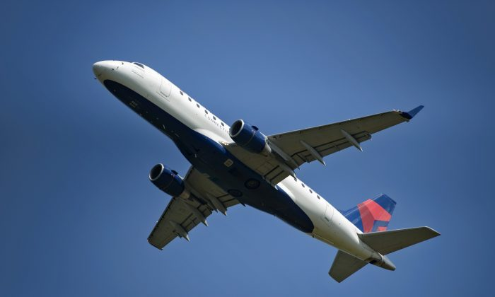 A Delta jet is seen from Gravelly Point Park after takeoff from National Airport in Arlington, Virginia, on July 24, 2015. (Brendan Smialowski/AFP/Getty Images)