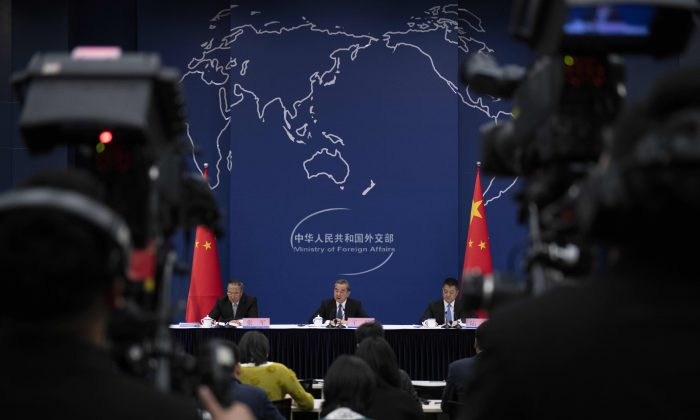 China's foreign minister speaks during a press conference briefing at the Ministry of Foreign Affairs in Beijing on April 19, 2019. (Nicolas Asfouri/AFP/Getty Images)