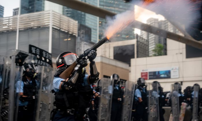 A police officer fire teargas during a protest in Hong Kong, on June 12, 2019. (Anthony Kwan/Getty Images)