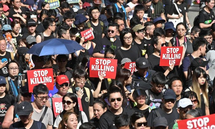 Protesters dressed in black take part in a rally against a proposed extradition bill in Hong Kong on June 16, 2019. (Anthony Wallace/AFP/Getty Images)
