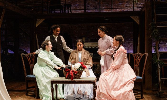 "The March family: (L–R) Meg (Kate Hamill), Jo (Kristolyn Lloyd), Marmie (Maria Elena Ramirez), Beth (Paola Sanchez Abreu), and Amy (Carmen Zilles) in Primary Stages' production of Kate Hamill's ""Little Women."" (James Leynse)"
