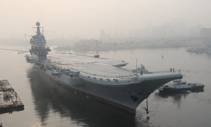 """China's first domestically manufactured aircraft carrier, known only as """"Type 001A"""", leaves port in the northeast city of Dalian early on May 13, 2018. AFP/Getty Images"""