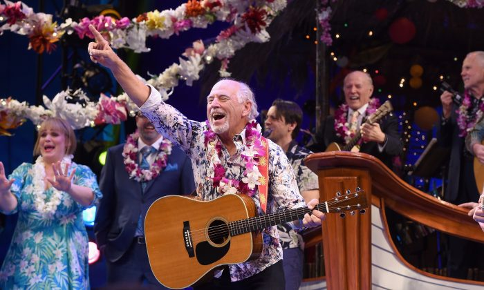 "Jimmy Buffett (C) takes an opening night bow during the Broadway premiere of the musical ""Escape to Margaritaville"" at the Marquis Theatre in New York City on March 15, 2018. (Noam Galai/Getty Images for Escape To Margaritaville)"