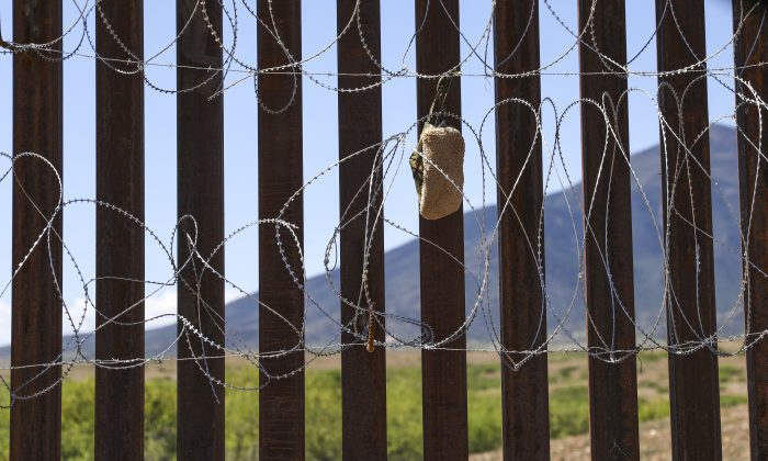 A carpet shoe, usually worn by smugglers and illegal aliens, is caught in the concertina wire on the U.S.-Mexico border fence near Sierra Vista, Ariz., on May 8, 2019. (Charlotte Cuthbertson/The Epoch Times)