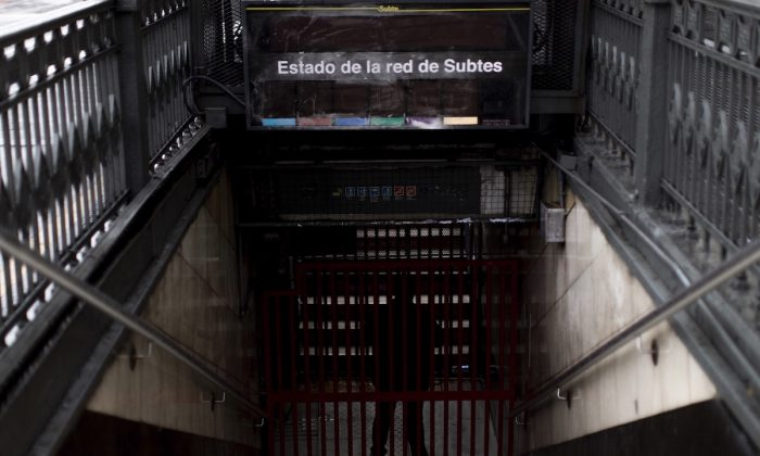 A subway employee stands in the closed entrance off Buenos Aires's Subway during the blackout, in Buenos Aires, Argentina, Sunday, June 16, 2019. (Tomas F. Cuesta/AP Photo)