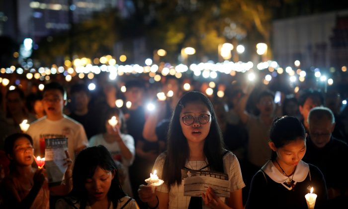 Thousands of people take part in a candlelight vigil to mark the 30th anniversary of the crackdown of pro-democracy movement at Beijing's Tiananmen Square in 1989, at Victoria Park in Hong Kong, China on June 4, 2019. (Tyrone Siu/Reuters)