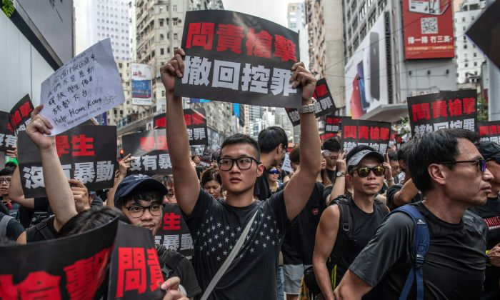 "Protesters demand that the authorities entirely withdraw the now-suspended extradition bill and retract its characterization of the demonstrations as a ""riot"" on June 16, 2019 in Hong Kong. (Carl Court/Getty Images)"