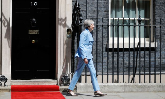 Britain's Prime Minister Theresa May walks out of 10 Downing street in London on June 17, 2019. (Tolga Akmen/AFP/Getty Images)