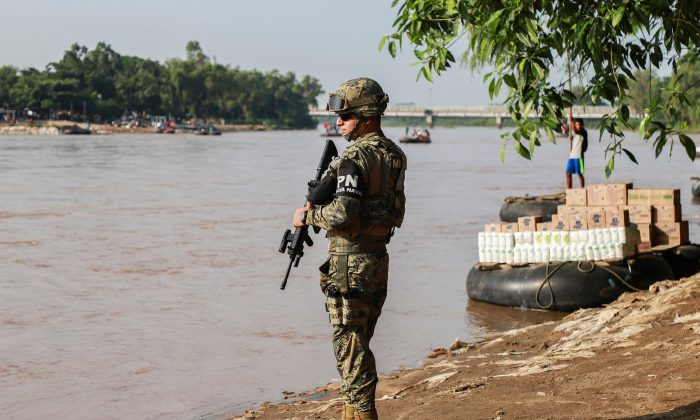 A naval police officer patrols the banks of the Suchiate river on the Mexico-Guatemala border in Ciudad Hidalgo, Chiapas State, Mexico, on June 17, 2019. (QUETZALLI BLANCO/AFP/Getty Images)