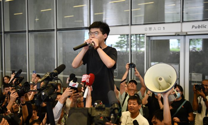Pro-democracy activist Joshua Wong speaks to the media and supporters outside the Legislative Council shortly after being released from prison in Hong Kong on June 17, 2019. (Carl Court/Getty Images)