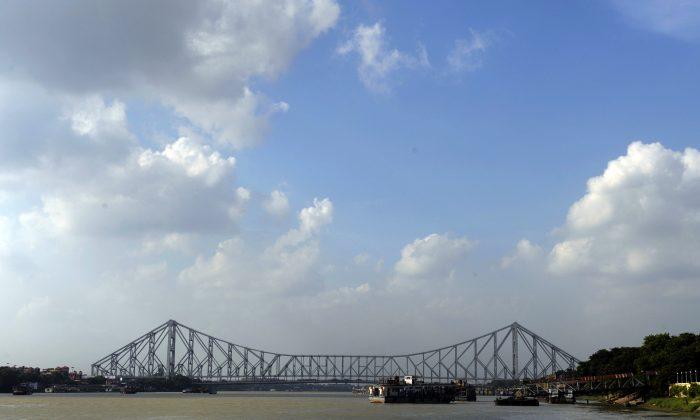 The Howrah Bridge straddles West Bengal's Hooghly River in Kolkata. (Deshakalyan Chowdhury/AFP/Getty Images)