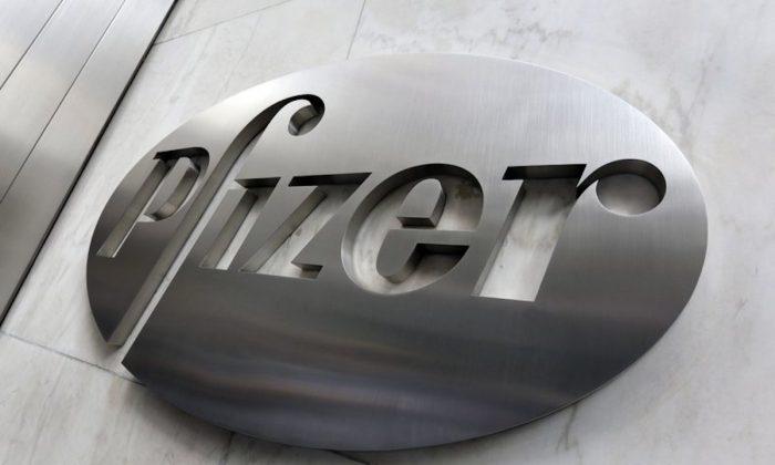 Pfizer company logo at the company's headquarters in New York. On Dec. 4, 2017.  (AP Photo/Richard Drewm Fuke)