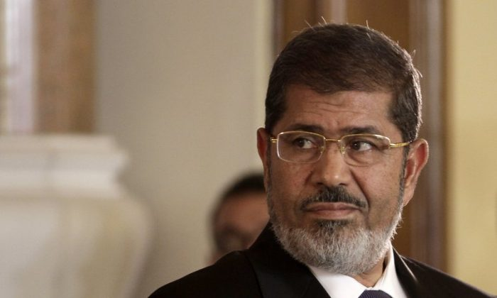 Egyptian President Mohammed Morsi holds a news conference with Tunisian President Moncef Marzouki, at the Presidential palace in Cairo, Egypt on July 13, 2012. (Maya Alleruzzo/File Photo via AP)