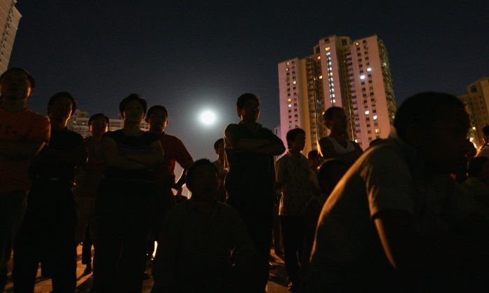 People at a housing district in China. (Guang Niu/Getty Images)