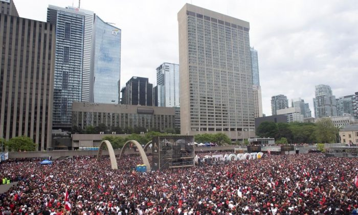 Crowds gather in Nathan Phillips Square as they prepare to celebrate the Toronto Raptors winning the NBA Championship in Toronto on June 17, 2019. (Chris Young/The Canadian Press)