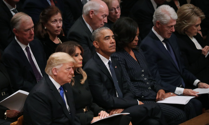 President Donald Trump and first lady Melania Trump, former President Barack Obama, Michelle Obama, former President Bill Clinton, Hillary Clinton, (2nd Row L-R) at the National Cathedral December 05, 2018 in Washington. (Chip Somodevilla/Getty Images)
