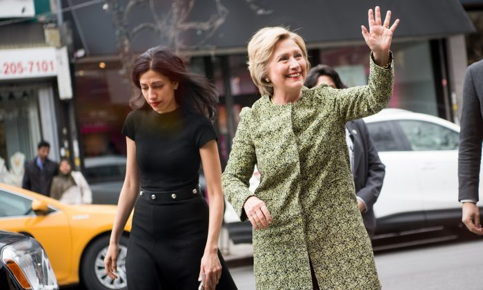 Then-Democratic presidential candidate Hillary Clinton (R) waves in the Flushing neighborhood of the Queens borough of New York City on April 11, 2016. (Andrew Theodorakis/Getty Images)