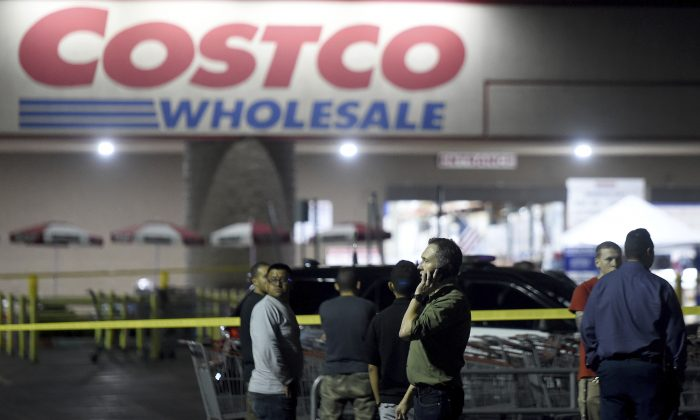 A Costco employee talks on the phone following a shooting within the wholesale outlet in Corona, Calif.,  on June 14, 2019. (Will Lester/Inland Valley Daily Bulletin/SCNG via AP)