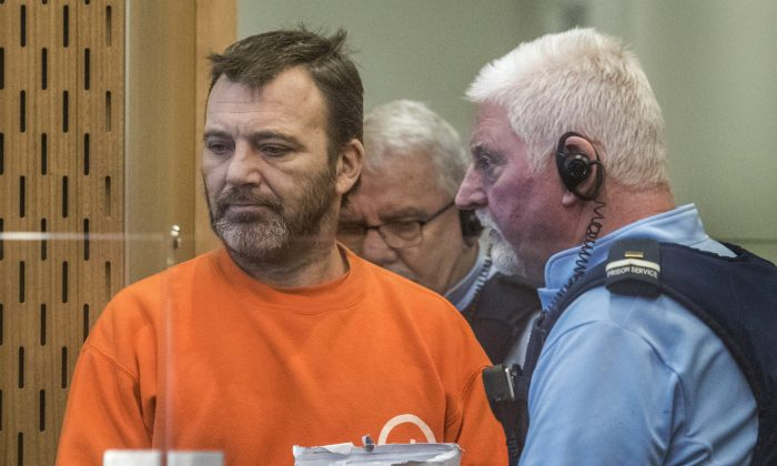 Philip Neville Arps, left, appears for sentencing in the Christchurch District Court, in Christchurch, New Zealand, Tuesday, June 18, 2019.  The Christchurch businessman who shared a video of worshippers being slaughtered at a New Zealand mosque has been sentenced to 21 months in prison. (John Kirk-Anderson/Pool/AP)