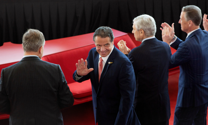 Gov. Andrew Cuomo greets attendees as he arrives at the new TWA Hotel at JFK Airport in New York City on May 15, 2019. (Kevin Hagen/Getty Images)