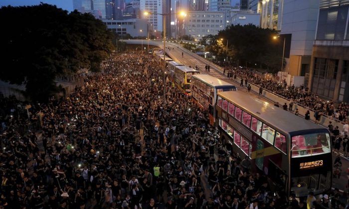 Protesters gather on a main road near the Legislative Council as they continue to protest against the unpopular extradition bill in Hong Kong on June 16, 2018. The largely youth-driven movement challenging Hong Kong's government over an unpopular extradition law is a coalition operating without a clear leadership structure. And that adds to its appeal for supporters disaffected from the moneyed elites who run the former British colony, organizers say. (Kin Cheung/AP)