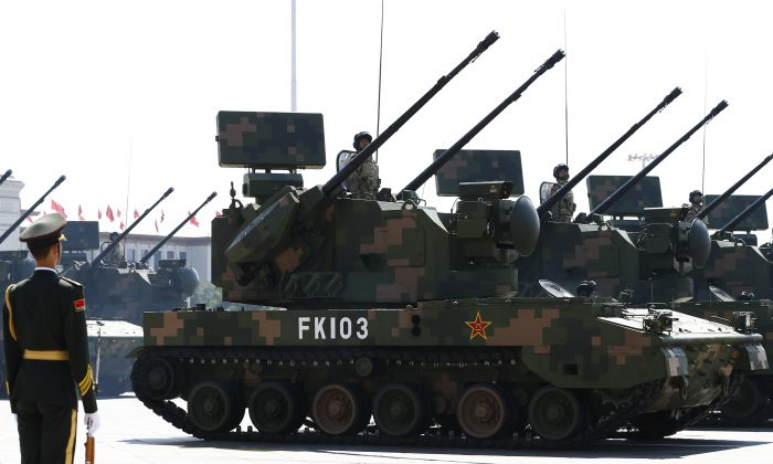 PGZ-07 self-propelled anti-aircraft artillery vehicles drive past the Tiananmen Gate during a military parade in Beijing on Sept. 3, 2015. (Getty Images)