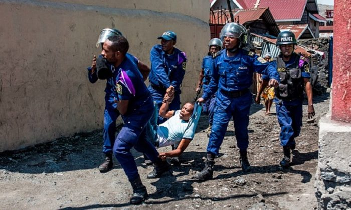 Congolese National Police arrest a man at Majengo neighborhood in Goma , during a demonstration  against the postponement, announced the day before by the Congolese national committee, of the general elections in this area because of the Ebola outbreak and the mass killings of civilians in this trouble part of DRC on Dec. 27, 2018 . (Patrick Meinhard/AFP/Getty Images)