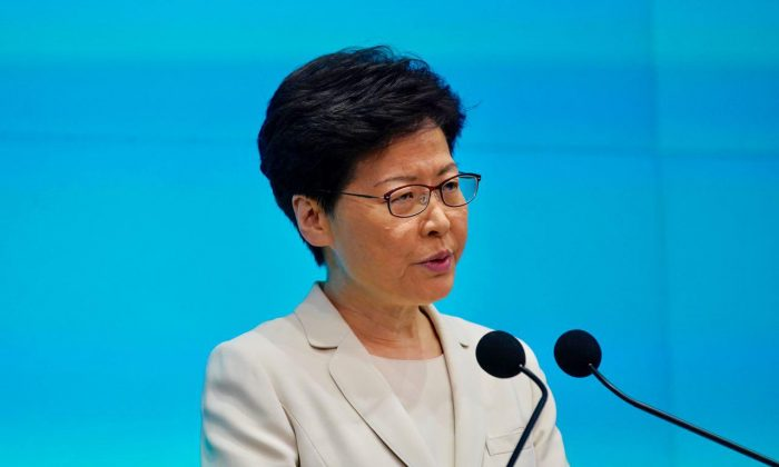 Hong Kong Chief Executive Carrie Lam speaks during a press conference at the government headquarters in Hong Kong on June 18, 2019. (Lin Yi/The Epoch Times)