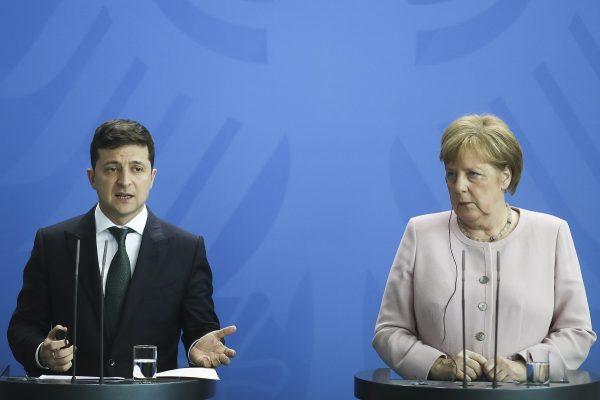 German Chancellor Angela Merkel, right, and Ukrainian President Volodymyr Zelenskiy, left, attend a joint news conference