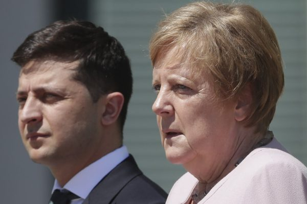 German Chancellor Angela Merkel welcomes Ukraine's President Volodymyr Zelenskiy with military honors for a meeting at the chancellery in Berlin,