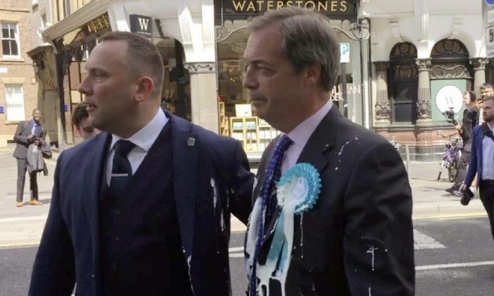 Brexit Party leader Nigel Farage after being hit with a milkshake during a campaign walkabout for the European elections in Newcastle, United Kingdom, on May 20, 2019. (Tom Wilkinson/PA via AP)