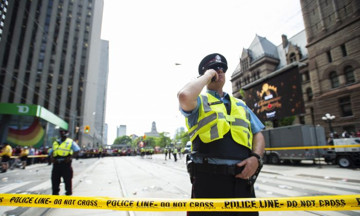 Toronto Police secure the scene after a shots were fired during the Toronto Raptors NBA basketball championship parade in Toronto, on June 17, 2019. (Andrew Lahodynskyj/The Canadian Press via AP)