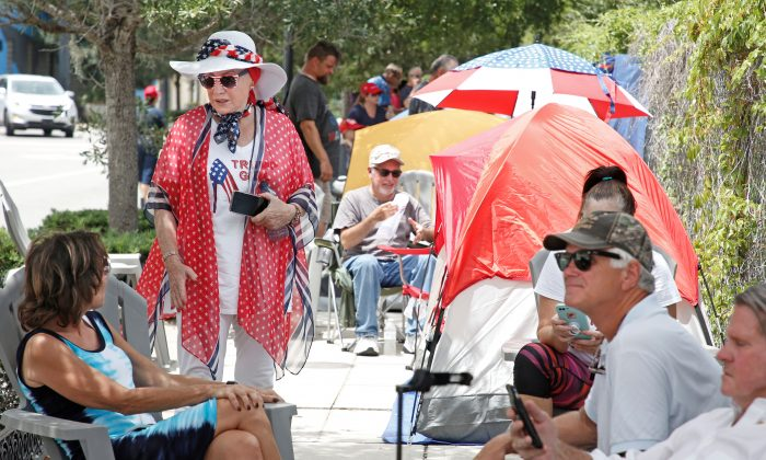 Supporters of President Donald Trump line up along one of the main streets outside the Amway Center in Florida, on June 17, 2019. (Gregg Newton/AFP/Getty Images)