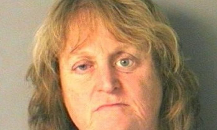 A New Hampshire woman faces an animal cruelty charge after pushing her 11-year-old dog into a lake and watching it drown. (Merrimack Police/CNN)