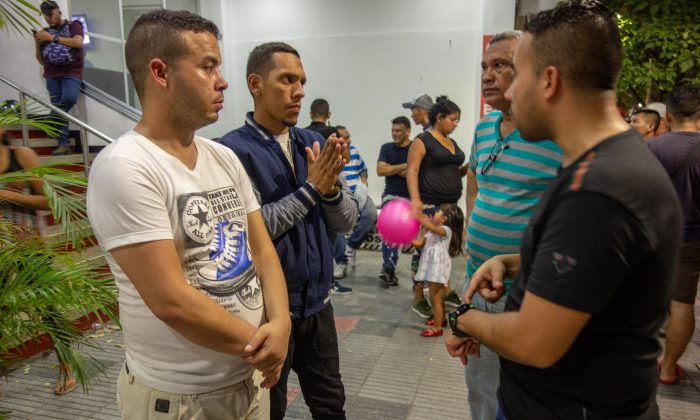 SOME DESERTERS DISCUSS THEIR NEXT STEPS OUTSIDE THE HOTEL THEY ARE CURRENTLY HOLED UP IN CÚCUTA ,COLOMBIA, on MAY 3 .