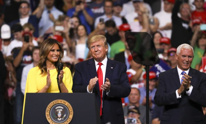 First Lady Melania Trump, President Donald Trump, and Vice President Mike Pence at Trump's 2020 re-election event in Orlando, Fla., on June 18, 2019. (Charlotte Cuthbertson/The Epoch Times)