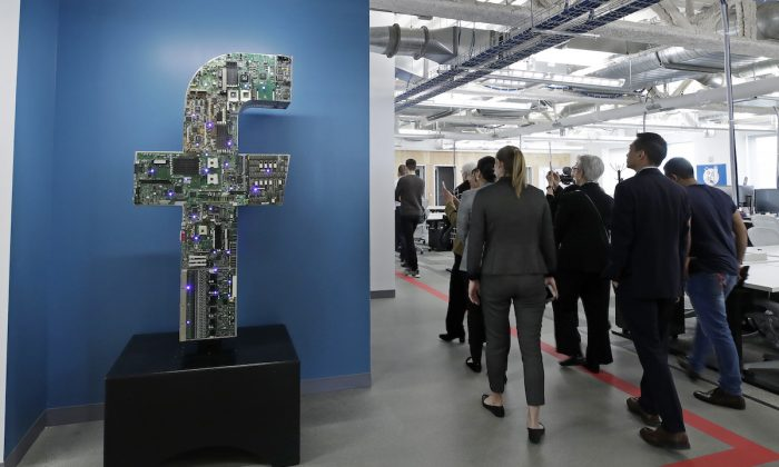 Media and guests tour Facebook's new 130,000-square-foot offices, which occupy the top three floors of a 10-story Cambridge, Mass., building, on Jan. 9, 2019. (Elise Amendola/AP Photo)