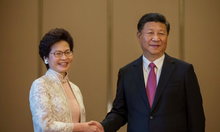 Chinese leader Xi Jinping (R) shakes hands with Hong Kong's new Chief Executive Carrie Lam (L) during their meeting in Hong Kong on July 1, 2017.