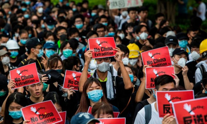 Protesters occupy a street demanding Hong Kong leader to step down after a rally against the now-suspended extradition bill outside of the Chief Executive Office in Hong Kong on June 17, 2019. (Anthony Kwan/Getty Images)