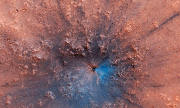 The impact crater likely formed between September 2016 and February 2019. (University of Arizona/JPL/NASA)
