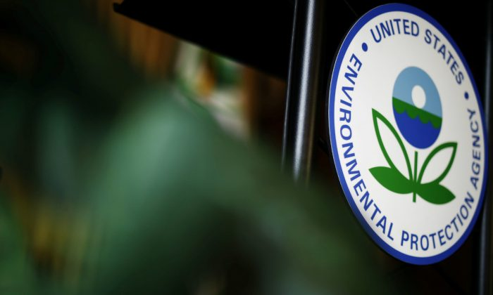 The U.S. Environmental Protection Agency (EPA) sign on the podium at EPA headquarters in Washington, on July 11, 2018. (Ting Shen/Reuters)