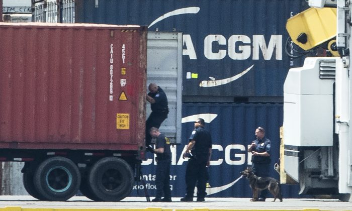 Authorities search a container along the Delaware River in Philadelphia, on June 18, 2019. (Matt Rourke/AP Photo)
