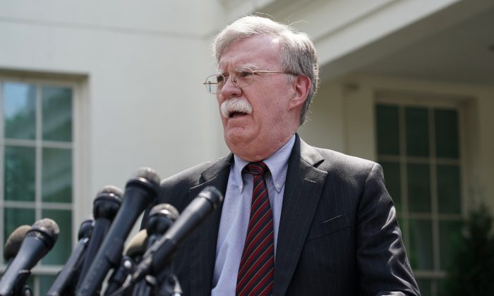 Then-White House National Security Advisor John Bolton talks to reporters outside of the White House in Washington on April 30, 2019. (Chip Somodevilla/Getty Images)